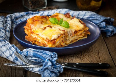 Piece of tasty hot lasagna. Small depth of field.