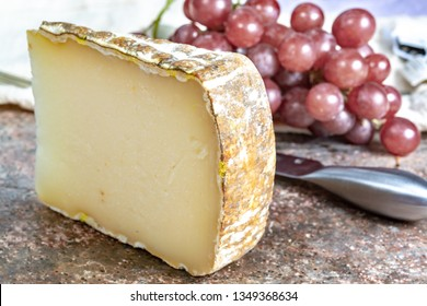 Piece of tasty Ossau-Iraty or Esquirrou sheep cheese produced in south-western France, Northern Basque Country