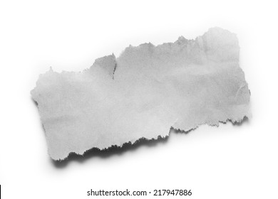 Piece of torn paper on plain background