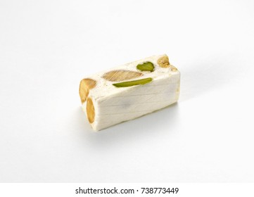 Piece of traditional nougat, on white background