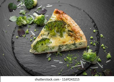 A piece of vegetable quiche with broccoli and cheese. Vegetarian pie.