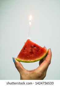 piece of watermelon with candle