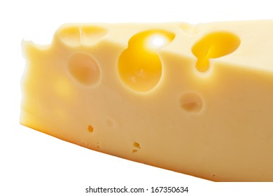 Piece of yellow cheese with holes, isolated on white background