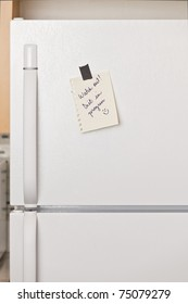 Piece of yellow paper taped to a refrigerator door