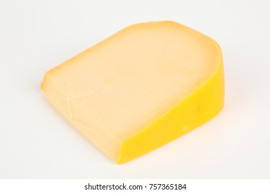 a piece of a young gouda with white background
