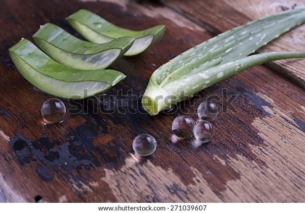 pieces of aloe vera with aloe vera leaf on wood