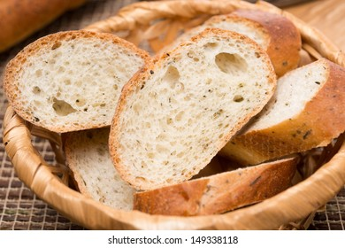 pieces of baguette with herbs in a basket, close-up, horizontal