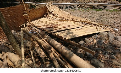 Pieces of bamboo and bamboo matting are broken on the rocks