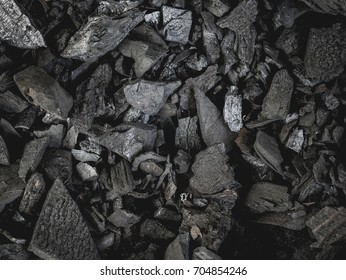 pieces of Black wood charcoal texture background.