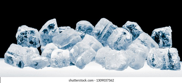 Pieces of blue crushed ice cubes on black background.