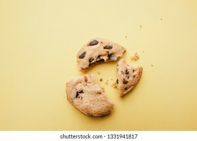 pieces of broken cookie, close up. crumbles, diet, part, sharing concept. minimal confectionery design