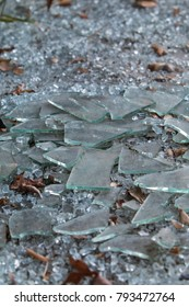 Pieces of broken glass lie on ground at vandalized building that has gone out of business