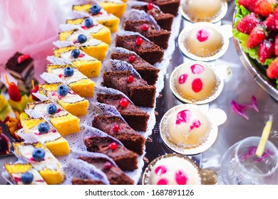 pieces of cake decorated with berries and cookies. candy bar. wedding.
