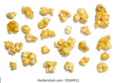 Pieces of caramel popcorn isolated on white