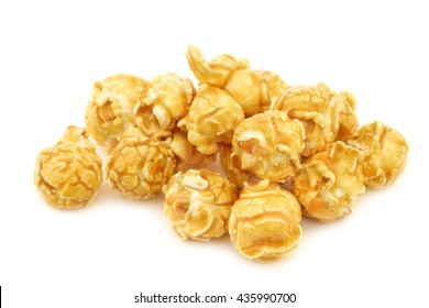 pieces of caramel popcorn on a white background