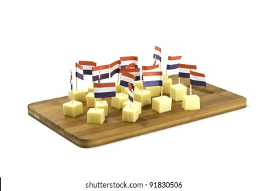 pieces of cheese with banner on the board
