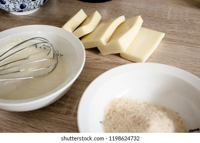 Pieces of cheese eidam and  bowls  - preparation for wrapping and frying