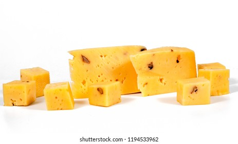 pieces of cheese with nuts on a white background