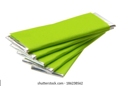 pieces of chewing gum with green packaging isolated on the white background