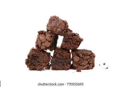 Pieces of chocolate baked brownies in a stacked pile isolated white background