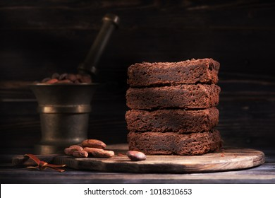Pieces chocolate brownie cake and cocoa beans