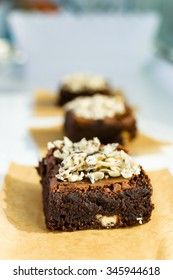 Pieces of chocolate brownie with nuts and topped with white chocolate