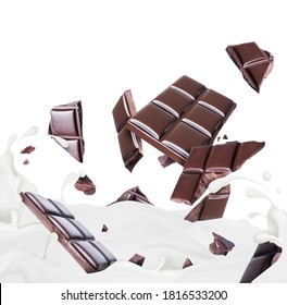 Pieces of chocolate drowning in milk splashes