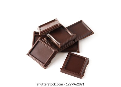 Pieces of chocolate isolated on white background