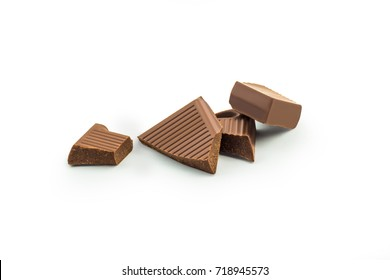 Pieces of chocolate isolated on white background. Clipping path included.