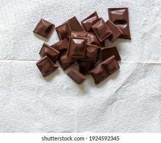 Pieces of chocolate on a napkin -´Top view