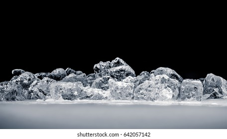 Pieces of crushed ice cubes on black background.