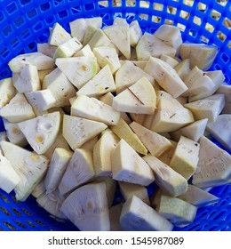 Pieces cut of young green jackfruit in blue basket