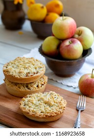 Pieces of delicious apple pie on wooden background