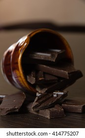 pieces of delicious dark chocolate in ceramic ware