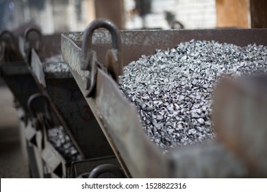 Pieces of ferrotitanium closeup. Ferroalloy used for alloying, deoxidation and degassing of steels and alloys