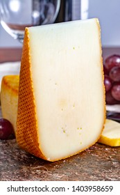 Pieces of french yellow cheeses, Pur Brebis sheep melk cheese fron Pyrenees and Saint Paulin creamy, mild, semi-soft French cheese from pasteurized cow milk