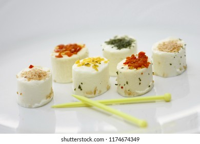 Pieces of fresh french cheese on a white plate