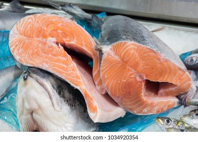 Pieces of fresh Norwegian salmon freshly cut at the fishmonger's counter