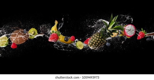 Pieces of fruit with mint leaves and ice cubes, falling in water splash, isolated on black background. Very high resolution image