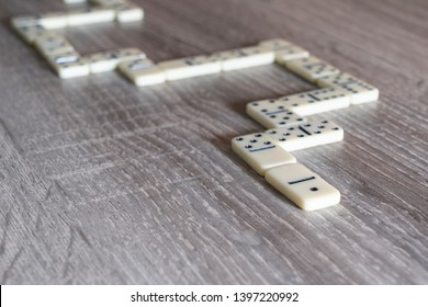 the pieces of the game of dominoes on the wooden table