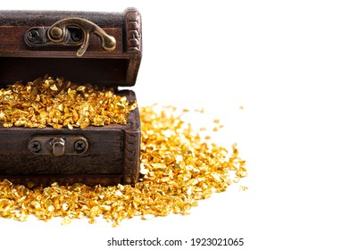 Pieces of Gold in a Treasure Chest Isolated on a White Background