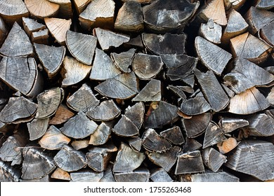 Pieces of gray firewood stacked up.