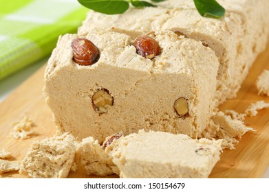Pieces of halva with nuts on a cutting board