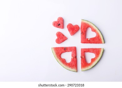 pieces of heart shape watermelon on white background with copyspace