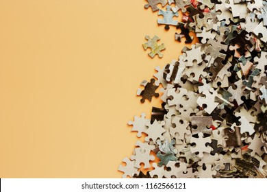 Pieces of jigsaw puzzle on beige color background for children educational toy