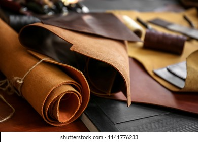 Pieces of leather on table