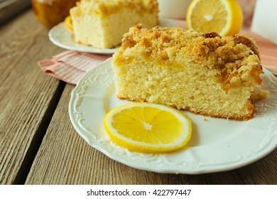 Pieces of lemon cake on white dish selective focus