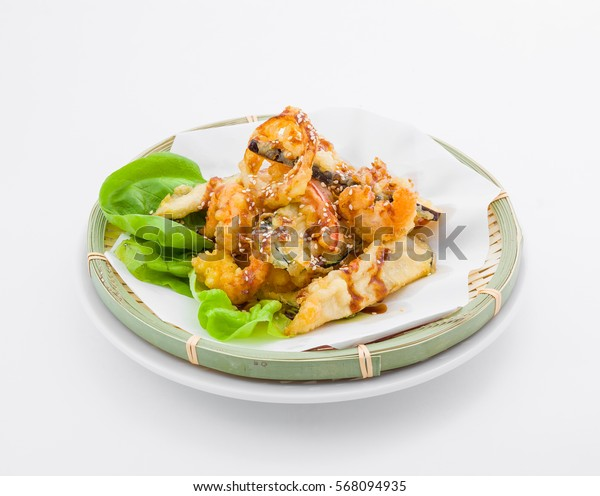 Pieces of meat in batter with herbs on original tray