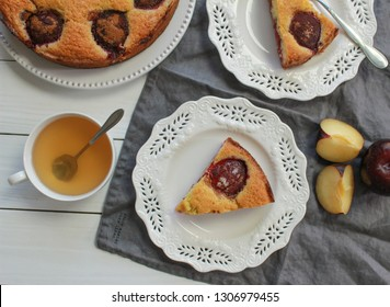 Pieces of The New York Times Famous Plum Torte on the white wooden background. Close-up, top view