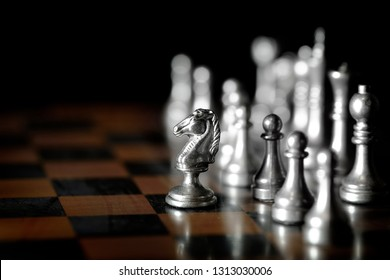 Pieces on chess board for playing game and strategy knight kingdom gaming